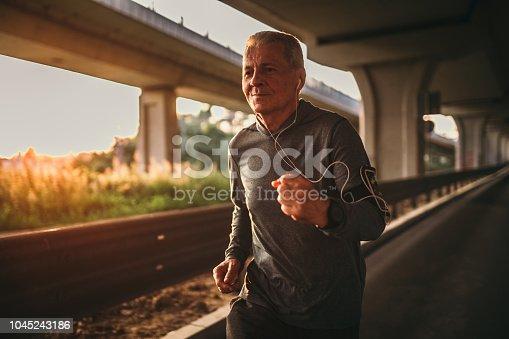 Senior jogging in the city