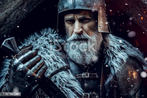 istock Senior knight  wearing traditional clothes with sword 1167562360