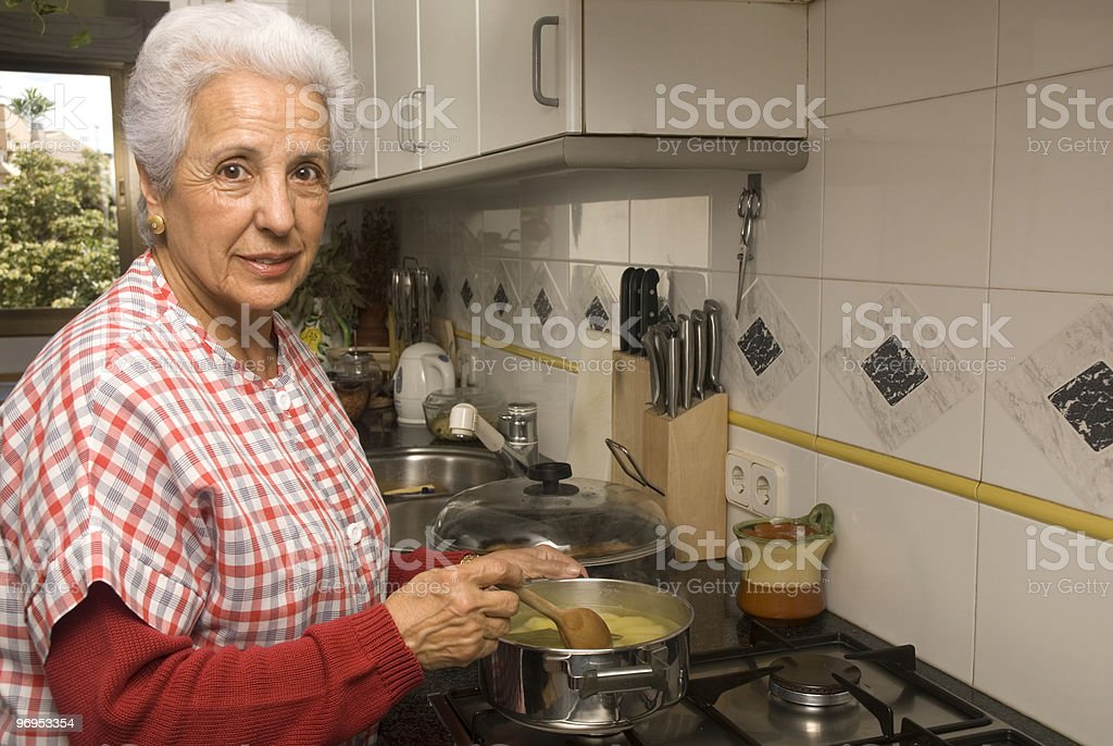 Senior lady at kitchen royalty-free stock photo
