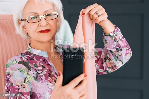 672064598istockphoto senior lady fashion blogger trendsetter lifestyle 1132968133