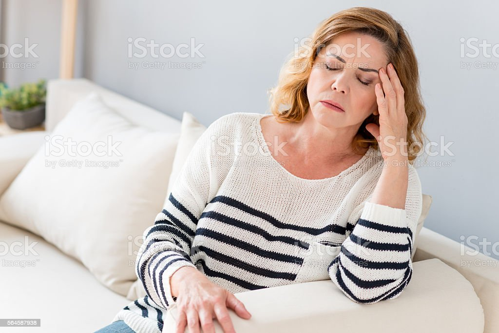 Senior lady feels pain in head stock photo
