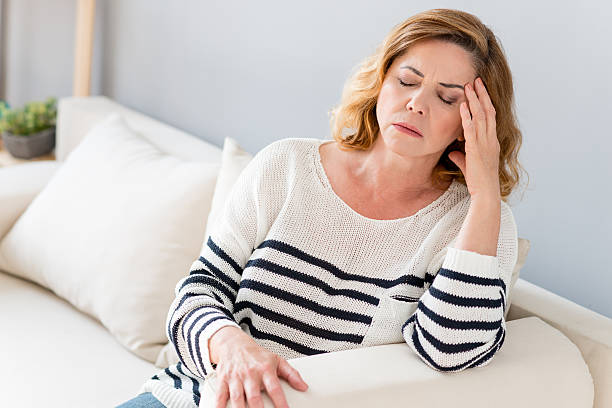 Senior lady feels pain in head stock photo
