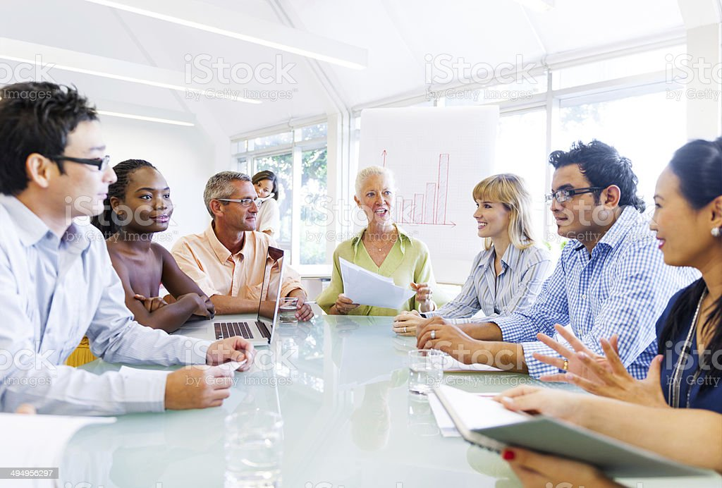 Senior Lady Giving an idea to her Colleagues stock photo