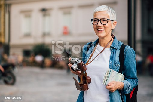 Woman travelling alone and photographing the city