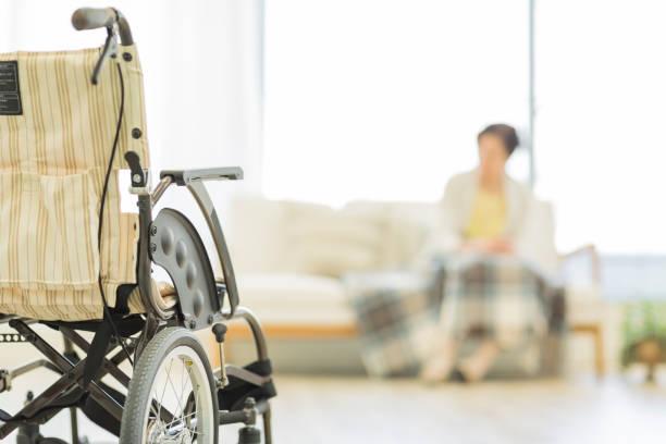 senior lady in a wheelchair - nursing home zdjęcia i obrazy z banku zdjęć