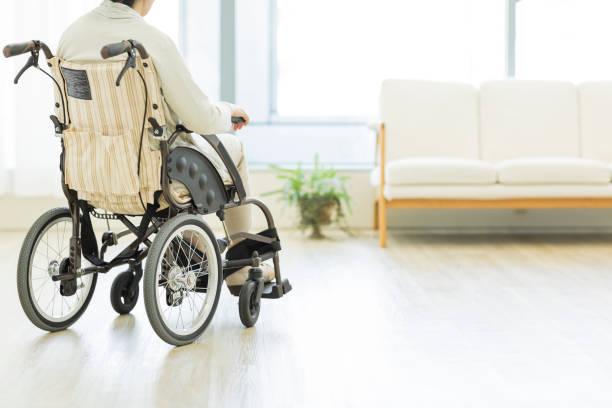 Senior lady in a wheelchair stock photo