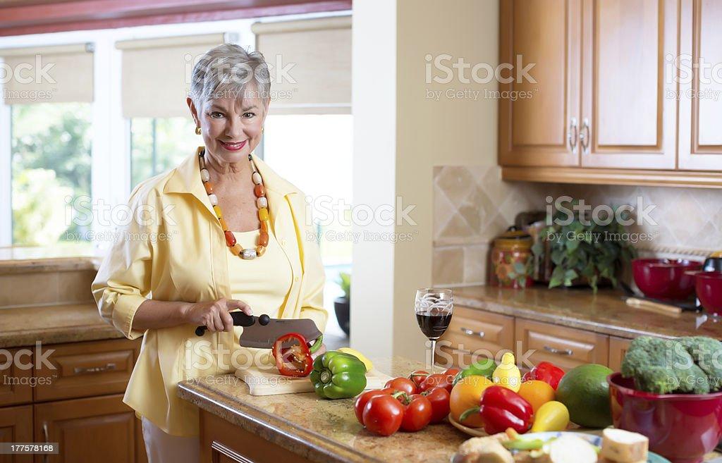 senior lady in the kitchen royalty-free stock photo