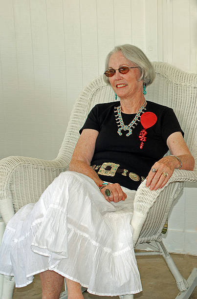 senior lady in wicker rocker - sessel türkis stock-fotos und bilder