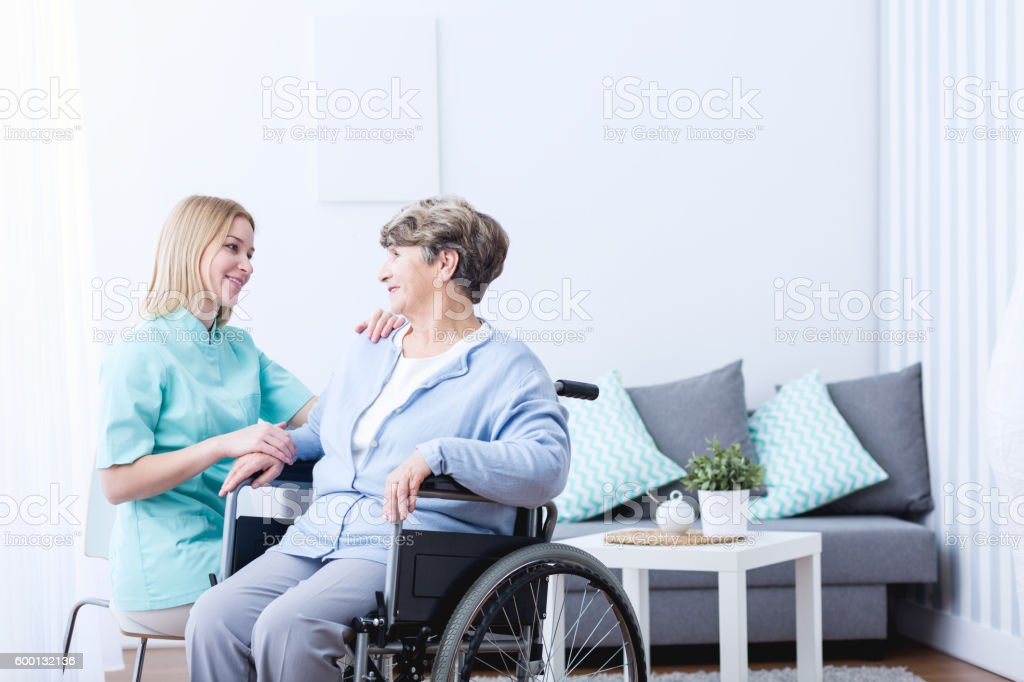 Senior lady on wheelchair stock photo