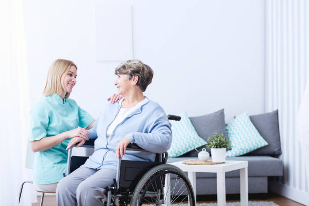 senior lady on wheelchair - psychiatric ward stock photos and pictures
