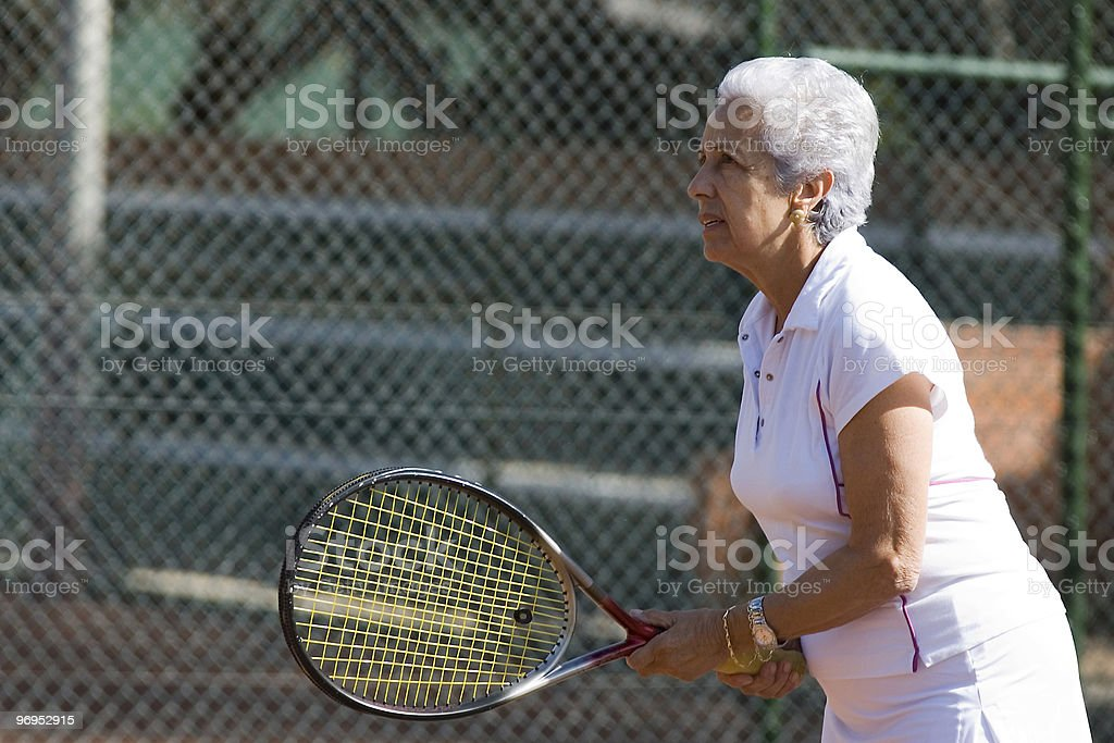 Senior lady playing tennis royalty-free stock photo