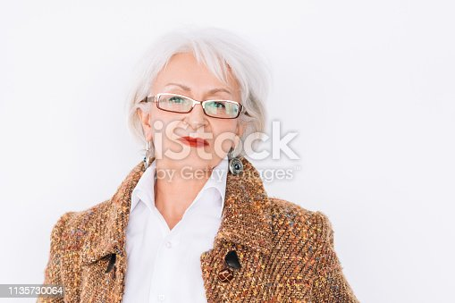 istock senior lady portrait confidence elegance trends 1135730064