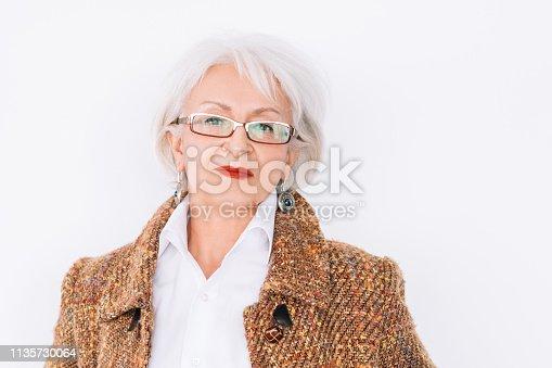 1133515238 istock photo senior lady portrait confidence elegance trends 1135730064
