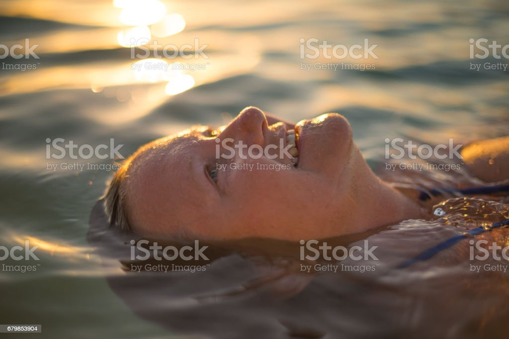 Senior lady relaxing in ocean royalty-free stock photo