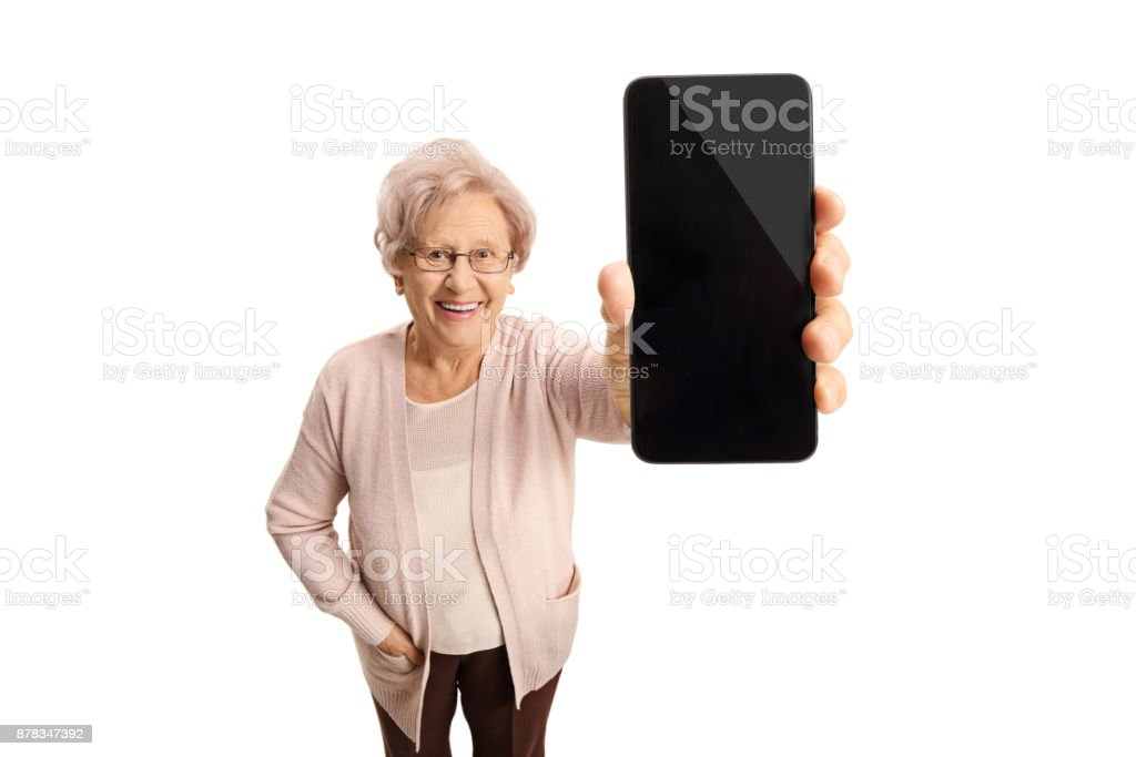 Senior lady showing a phone and smiling stock photo