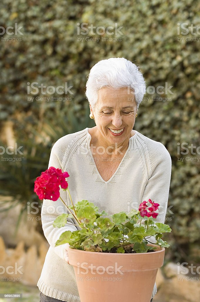 Senior lady taking care of her plants royalty-free stock photo