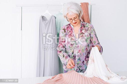 1133515238 istock photo senior lady wardrobe shopping trendy clothing 1132968135