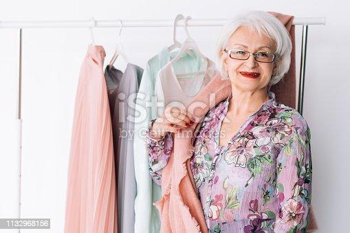1133515238 istock photo senior lady wardrobe shopping trendy clothing 1132968156