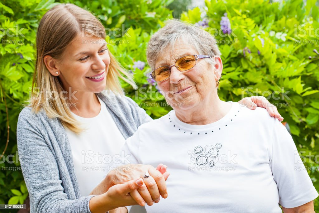 Senior lady with beautiful granddaughter stock photo