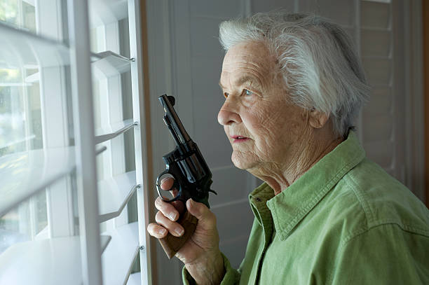 Senior Lady with gun stock photo