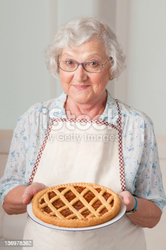 istock Senior lady with homemade cake 136978362