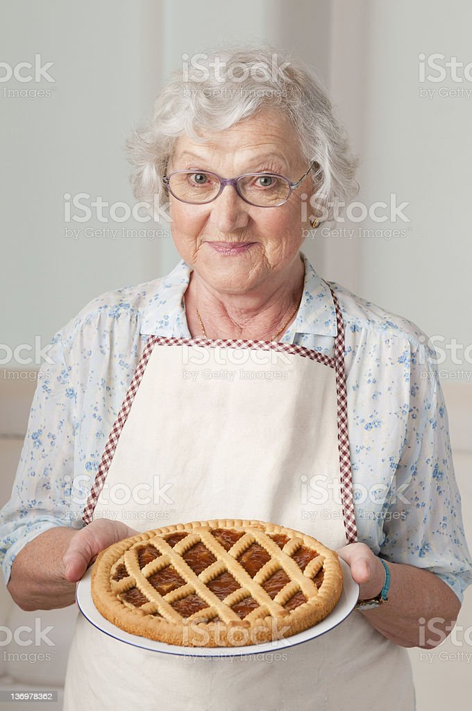 Senior lady with homemade cake stock photo