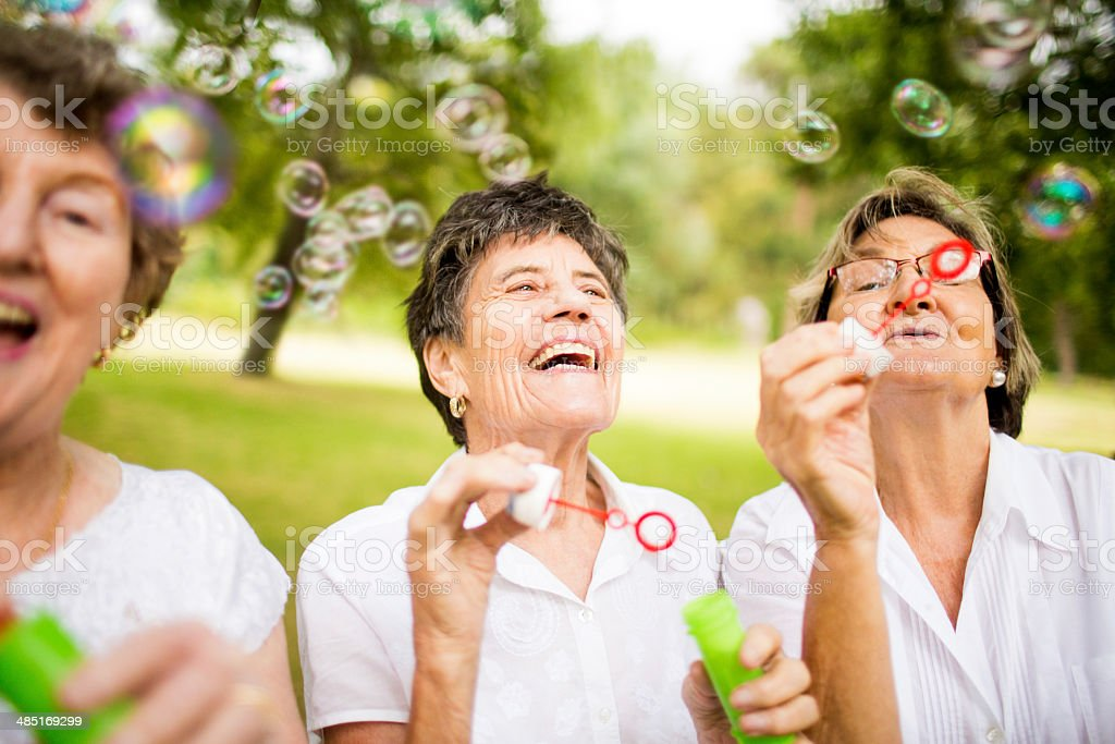 Senior ladys blowing bubbles stock photo