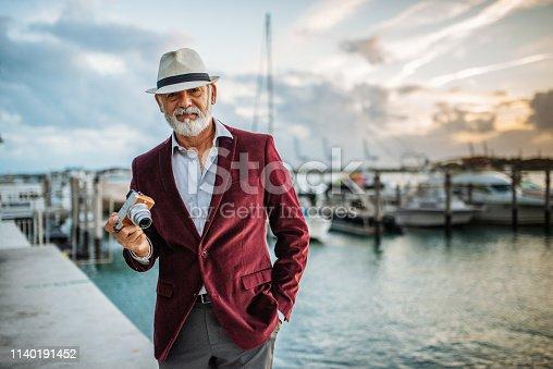 Portrait of senior Latin tourist in Miami, USA