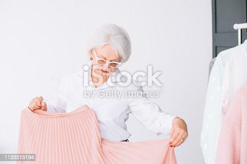1133515238 istock photo senior lifestyle fashion clothes shopping lady 1133515194