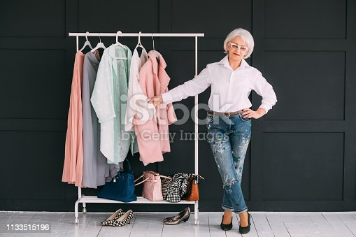 1133515238 istock photo senior lifestyle fashion clothes shopping lady 1133515196