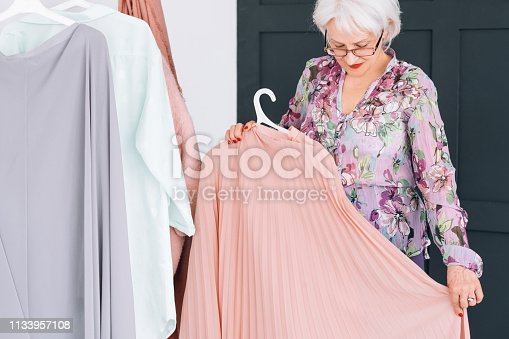 istock senior lifestyle fashion clothes shopping lady 1133957108
