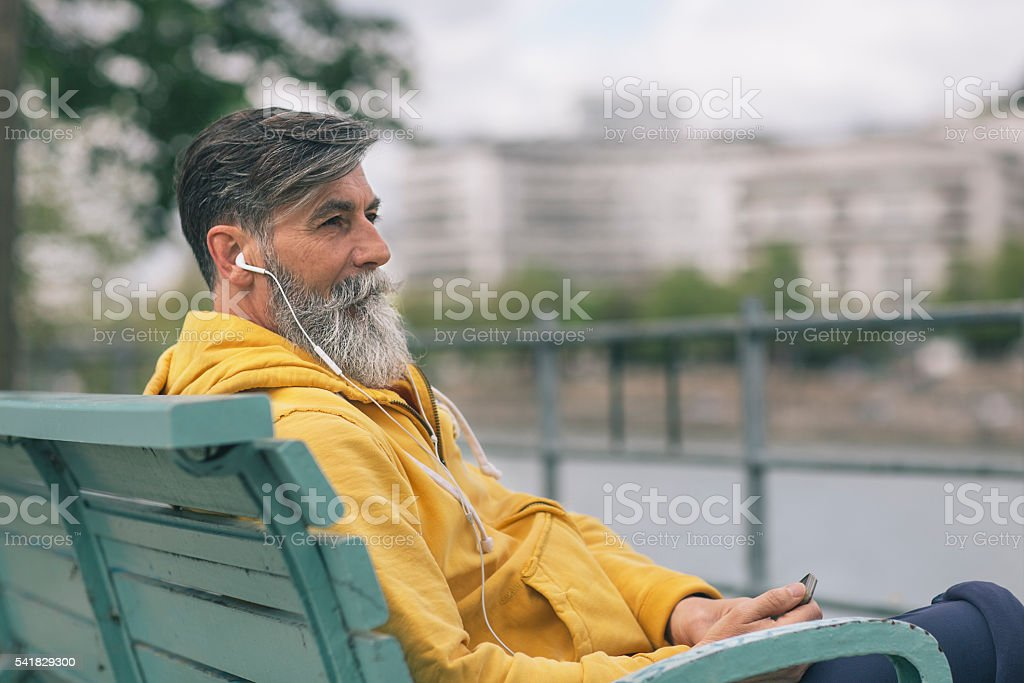 Senior listening to music stock photo