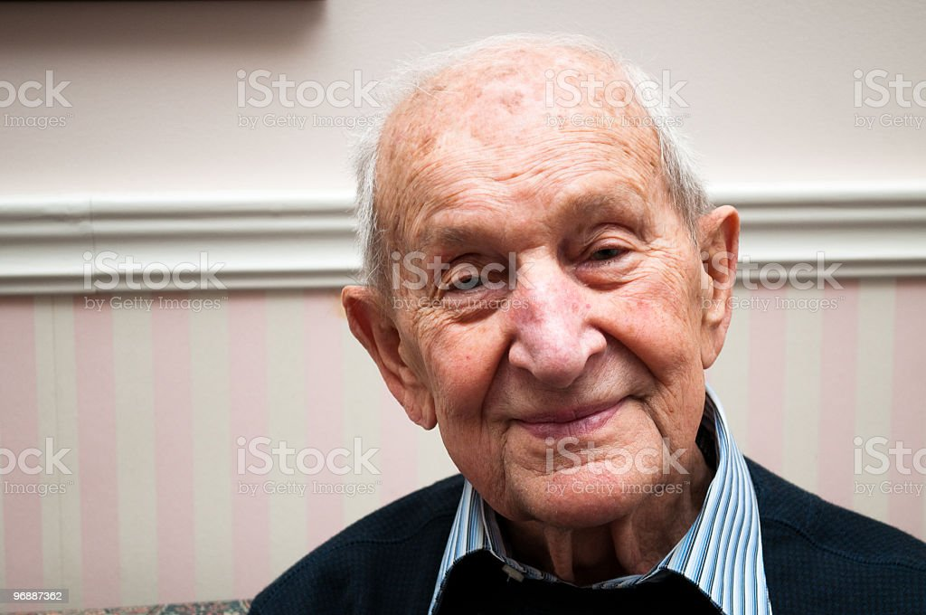 Senior male 88 years old smiling in his living room stock photo