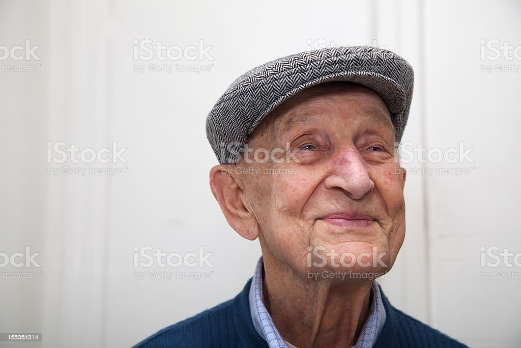 Senior male 90 years old wearing grey herringbone flat cap stock photo