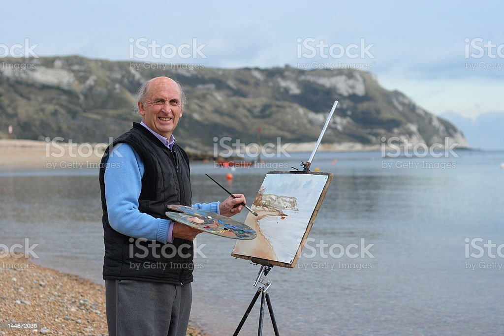 Senior male artist painting royalty-free stock photo