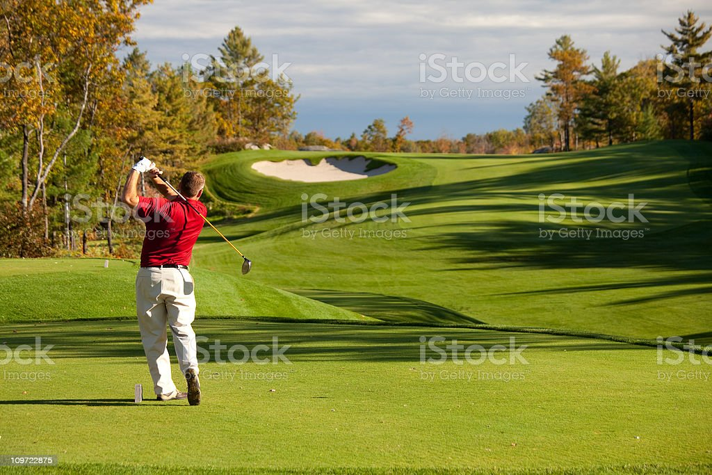 Senior Male Caucasian Golfer Driving off the Tee in Fall stock photo