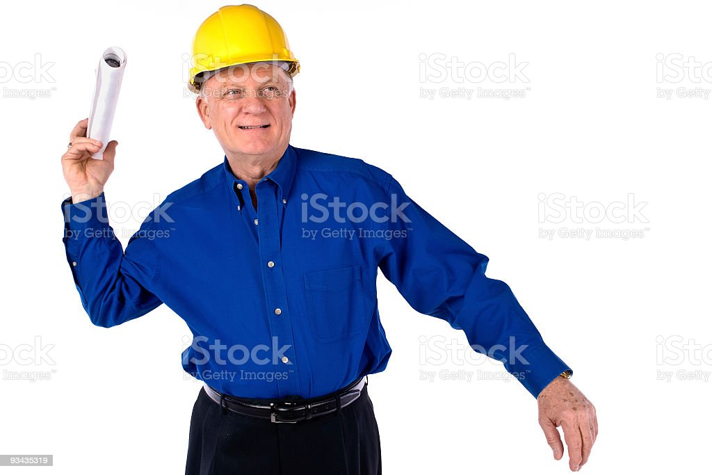 Senior male contractor wearing hard hat delivering construction plans royalty-free stock photo