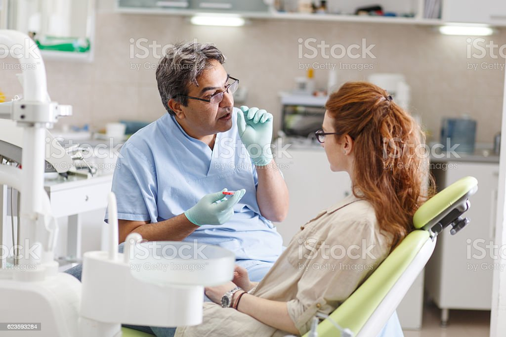 Senior male dentist in dental office - foto de acervo
