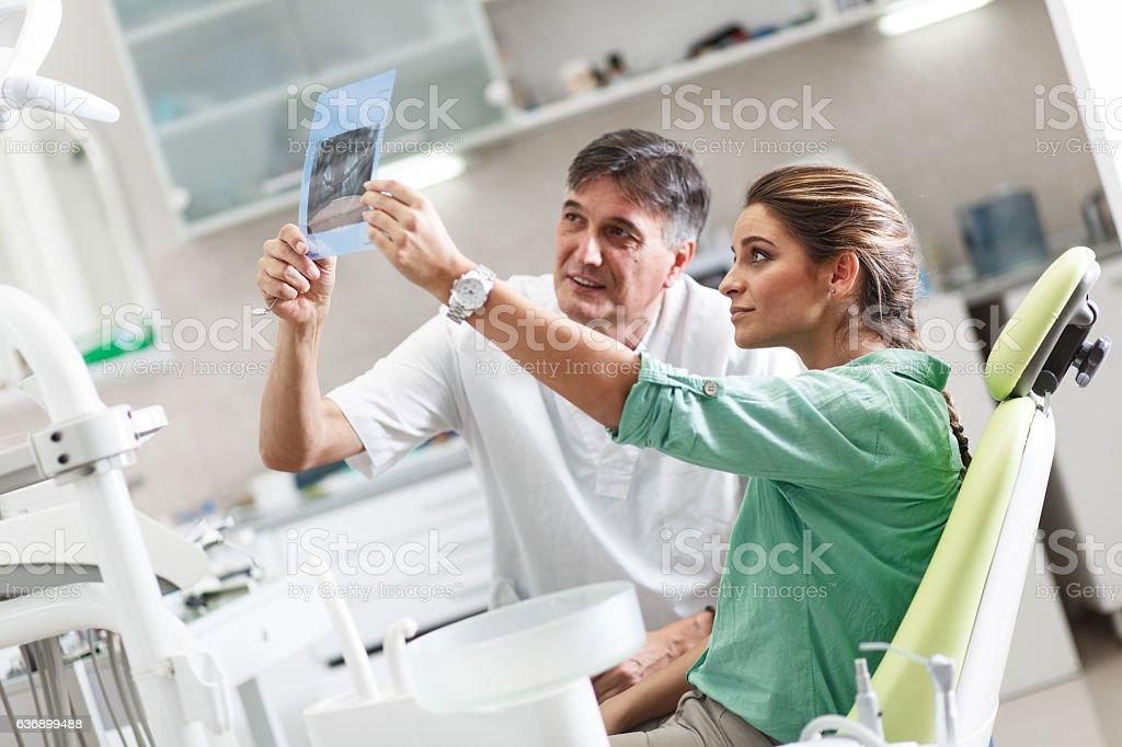 Senior male dentist in dental office stock photo