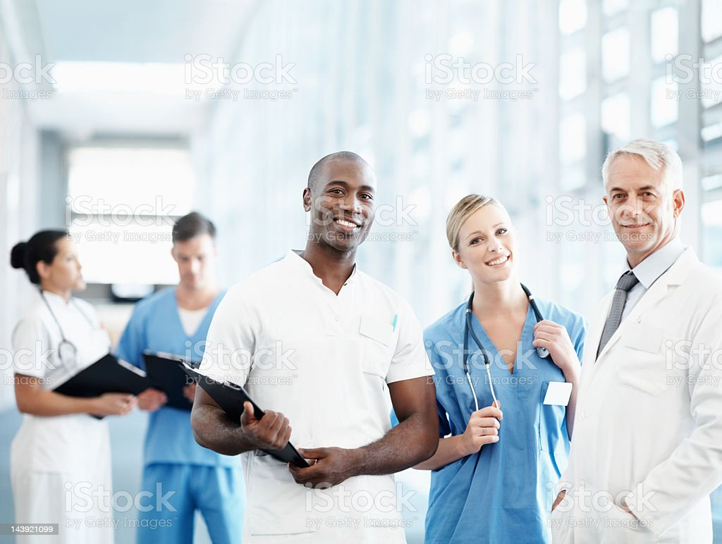 Senior male doctor and his medical team royalty-free stock photo