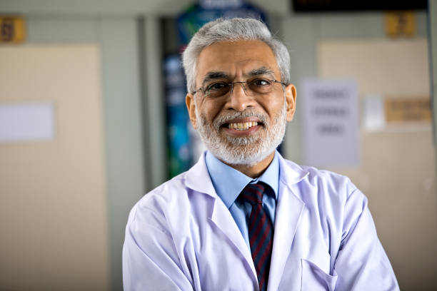 Senior male doctor looking at camera stock photo