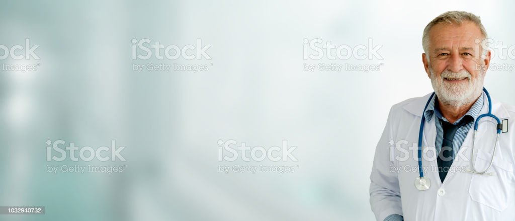 Senior male doctor working at the hospital. stock photo