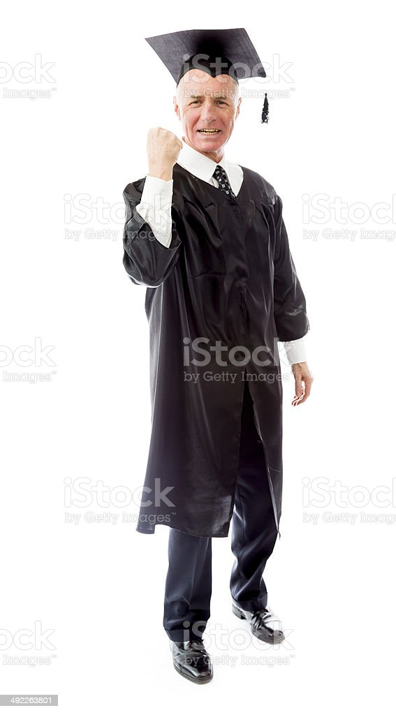 Senior male graduate punching the air royalty-free stock photo
