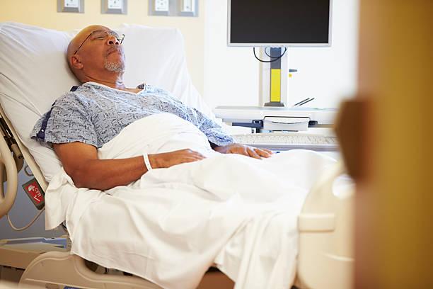 Senior Male Patient Resting In Hospital Bed stok fotoğrafı