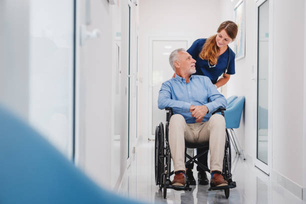 Senior male patient sitting in wheelchair in hospital corridor with picture id1271327416?b=1&k=6&m=1271327416&s=612x612&w=0&h=huo9lbfhpo0ojiwqk47 yjv czw3ju4z5utqxlmbdsw=