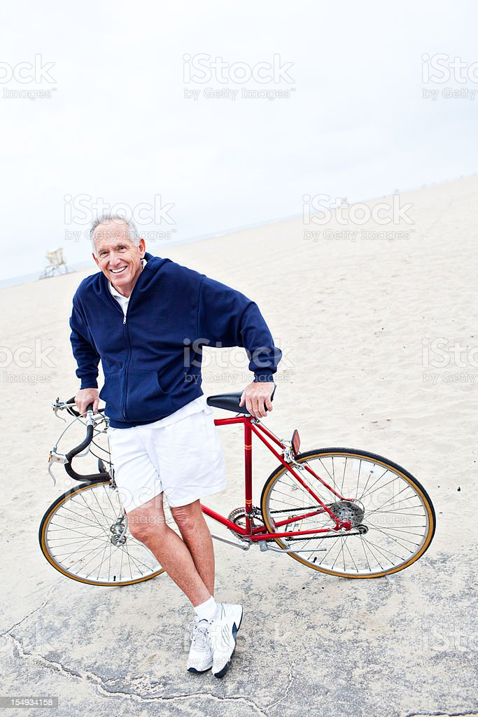 senior male posing infront of bike smiling royalty-free stock photo