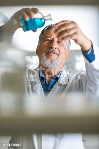 661098200istockphoto Senior male researcher carrying out scientific research in a lab 1070005938