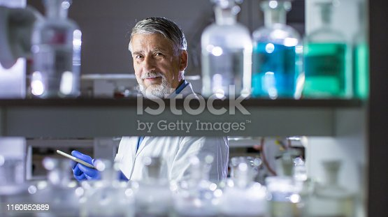 661098200istockphoto Senior male researcher carrying out scientific research in a lab 1160652689
