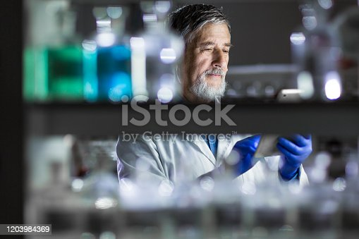 661098200istockphoto Senior male researcher carrying out scientific research in a lab 1203984369