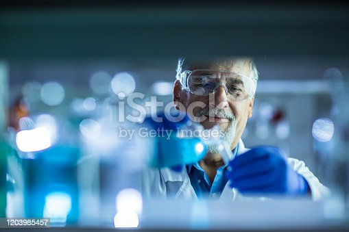 661098200istockphoto Senior male researcher carrying out scientific research in a lab 1203985457